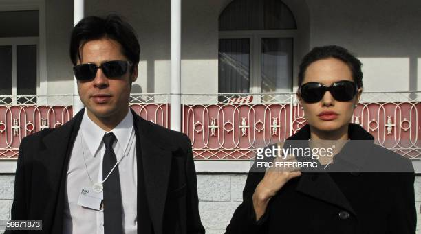 Actors Angelina Jolie and Brad Pitt leave Hotel Belvedere in Davos 26 January 2006 UN goodwill ambassador Angelina Jolie is in Davos for the World...