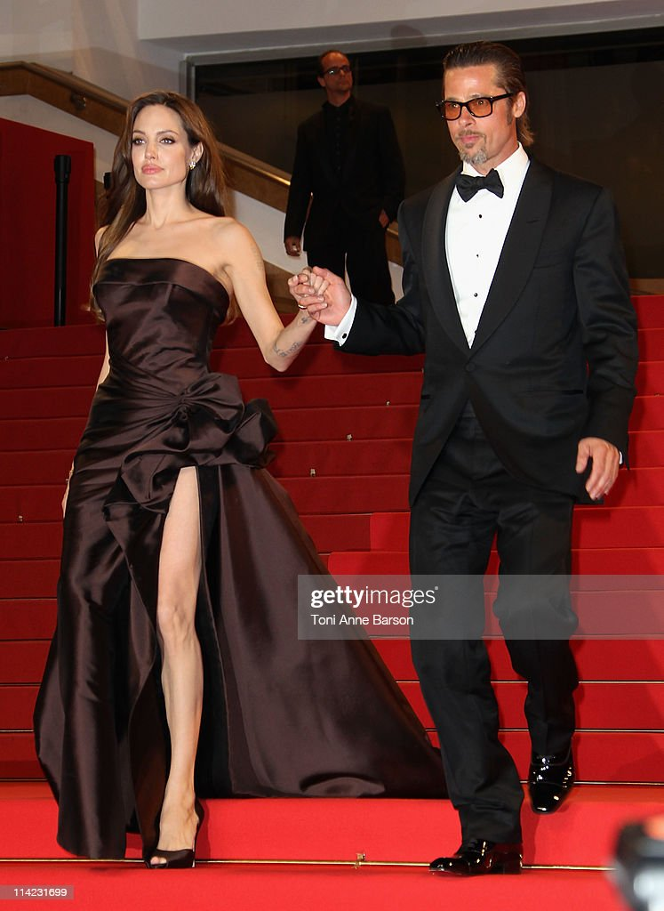 Actors Angelina Jolie and Brad Pitt leave 'The Tree Of Life' Premiere during the 64th Annual Cannes Film Festival at Palais des Festivals on May 16, 2011 in Cannes, France.
