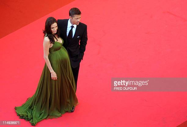 US actors Angelina Jolie and Brad Pitt pose as they arrive to attend the screening of US directors John Stevenson and Mark Osborne's animated film...