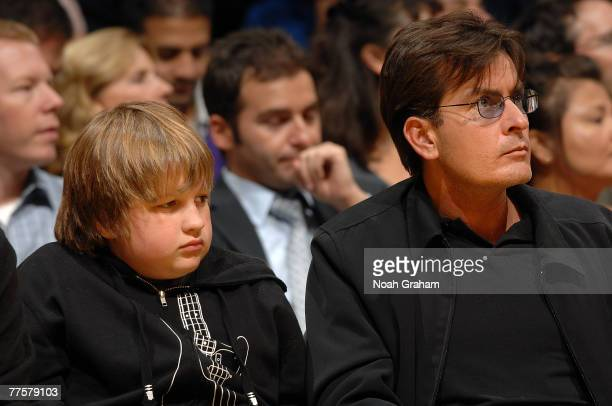 Actors Angus T Jones and Charlie Sheen of Two and a Half Men watch the game between the Houston Rockets and the Los Angeles Lakers at Staples Center...