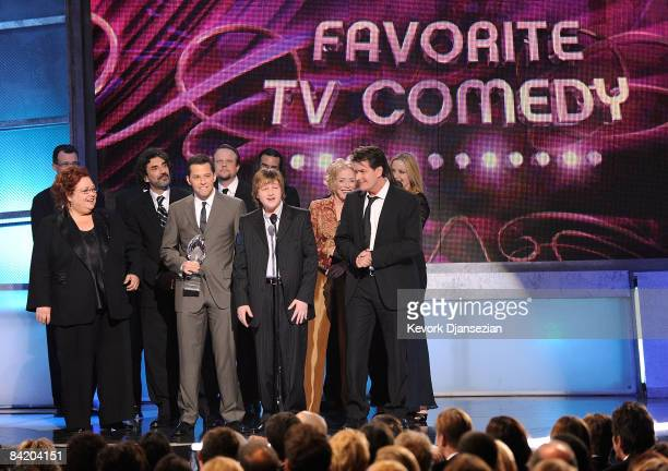 Actors Angus T Jones Jon Cryer Charlie Sheen and cast members accept the Favorite TV Comedy award for Two and a Half Men during the 35th Annual...