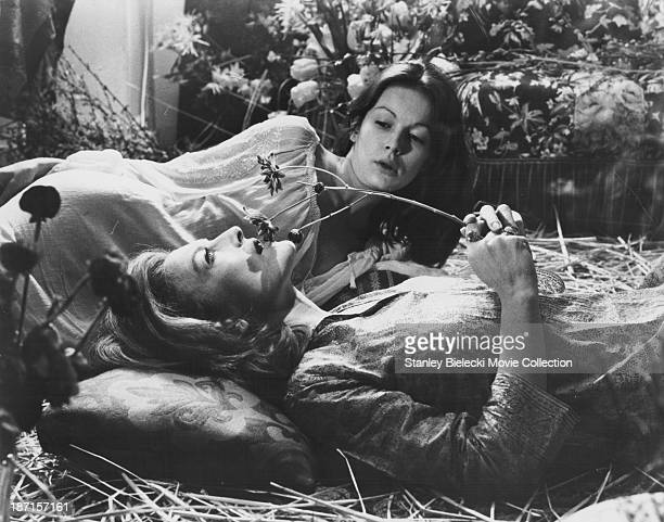 Actors Anicee Alvina and Nicole Courcel in a scene from the film 'The Beguines' 1972