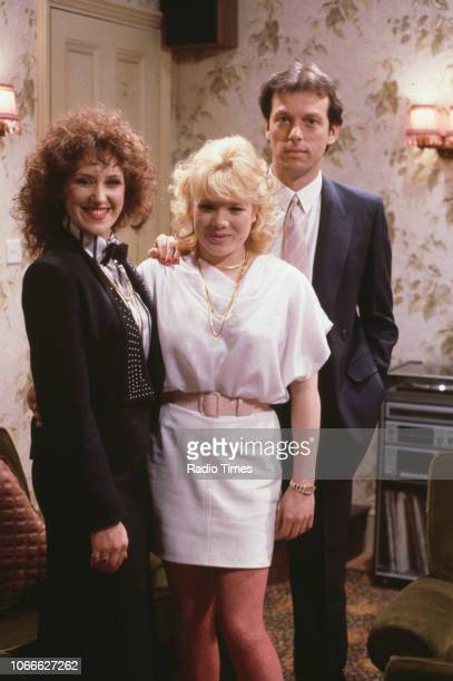 Actors Anita Dobson Letiti Dean and Leslie Grantham pictured on the set of the BBC soap opera 'EastEnders' 1986