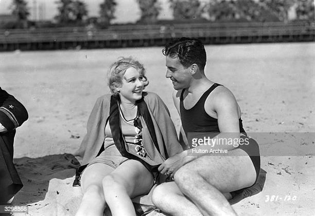 Actors Anita Page and Ramon Novarro as they appear in the film 'Flying Ensign', aka 'Flying Fleet', directed by George W Hill for MGM.