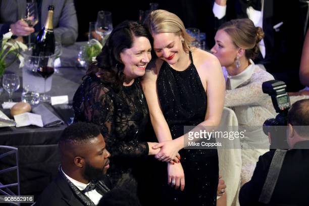 Actors Ann Dowd and Elisabeth Moss during the 24th Annual Screen Actors Guild Awards at The Shrine Auditorium on January 21, 2018 in Los Angeles,...