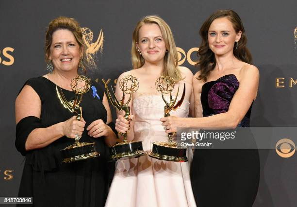 Actors Ann Dowd, Elisabeth Moss and Alexis Bledel of 'The Handmaid's Tale,' winner of the award for Outstanding Drama Series, pose in the press room...