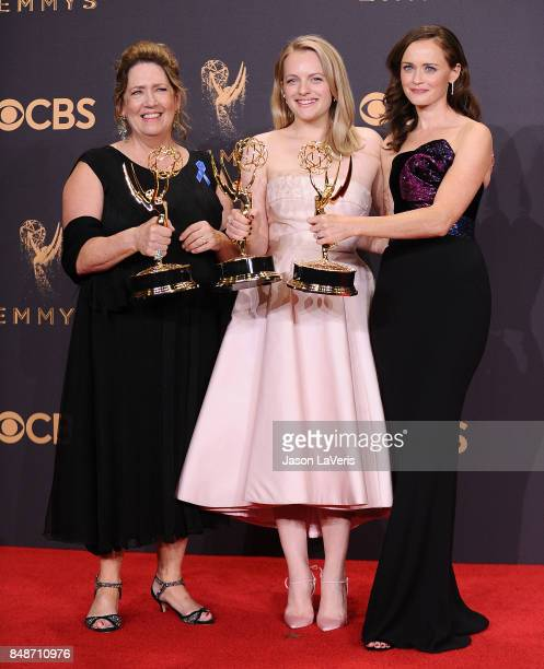 Actors Ann Dowd, Elisabeth Moss, and Alexis Bledel, winners of the award for Outstanding Drama Series for 'The Handmaid's Tale,' pose in the press...