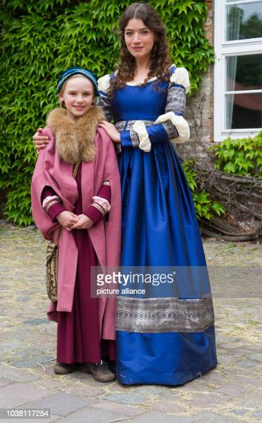 Actors Anna Bederke as Kathrin and Jule Hermann as Marie pose during filming for the ARD Christmas movie 'Till Eulenspiegel' at Luene Abbey...