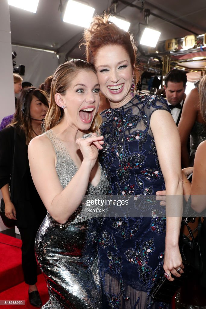 Actors Anna Chlumsky (L) and Ellie Kemper walk the red carpet during the 69th Annual Primetime Emmy Awards at Microsoft Theater on September 17, 2017 in Los Angeles, California.