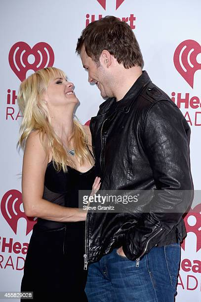 Actors Anna Faris Chris Pratt pose in the press room during the 2014 iHeartRadio Music Festival at MGM Grand Garden Arena on September 20 2014 in Las...