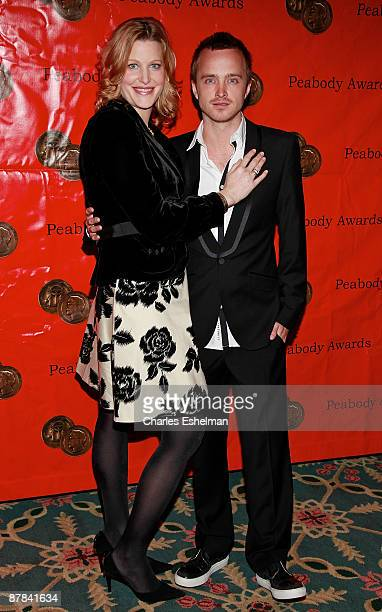 Actors Anna Gunn and Aaron Paul accept the AMC Peabody Award at the 68th Annual George Foster Peabody Awards at The Waldorf Astoria on May 18 2009 in...