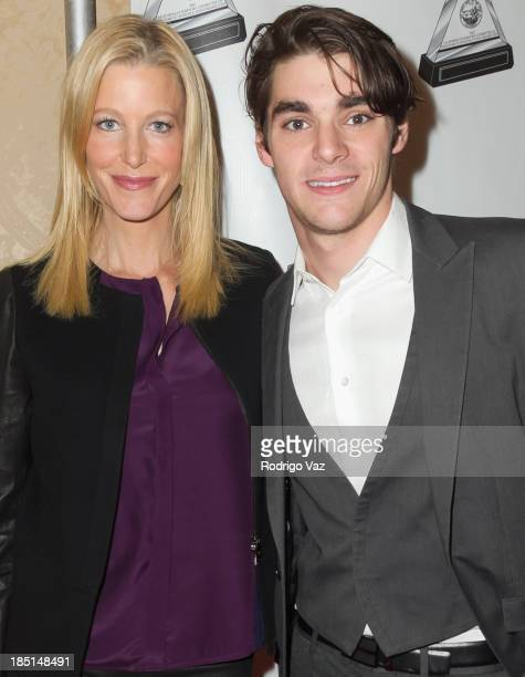 Actors Anna Gunn and RJ Mitte arrive at the 2013 Media Access Awards at The Beverly Hilton Hotel on October 17, 2013 in Beverly Hills, California.