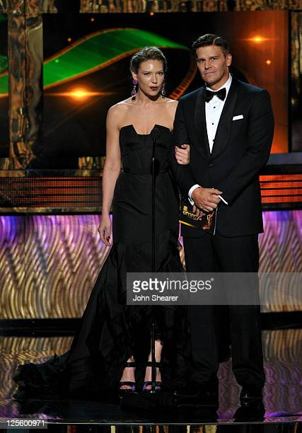 Actors Anna Torv and David Boreanaz speak onstage during the 63rd Primetime Emmy Awards at the Nokia Theatre LA Live on September 18 2011 in Los...