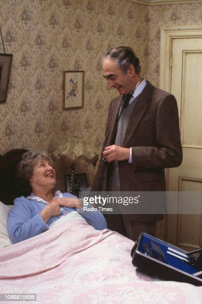 Actors Anna Wing and Leonard Fenton in a scene from the BBC soap opera 'EastEnders' January 9th 1985