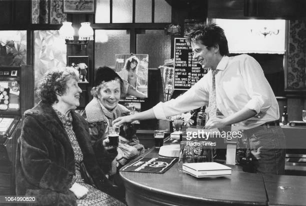 Actors Anna Wing Gretchen Franklin and Tom Watt in a pub scene from the television soap opera 'EastEnders' December 18th 1984
