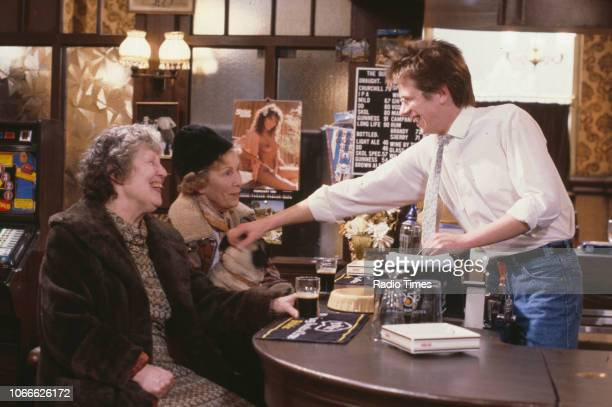 Actors Anna Wing Gretchen Franklin and Tom Watt in a scene from the BBC soap opera 'EastEnders' November 21st 1984
