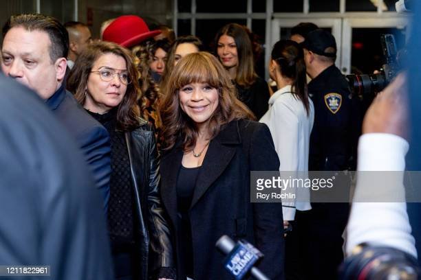 Actors Annabella Sciorra and Rosie Perez walk out of the courthouse after movie mogul Harvey Weinstein was sentenced to 23 years in prison on March...