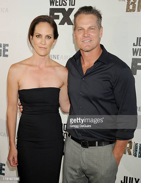 Actors Annabeth Gish and Brian Van Holt arrive at the series premiere of FX's The Bridge at DGA Theater on July 8 2013 in Los Angeles California