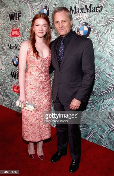 Actors Annalise Basso and Viggo Mortensen attend the tenth annual Women in Film PreOscar Cocktail Party presented by Max Mara and BMW at Nightingale...