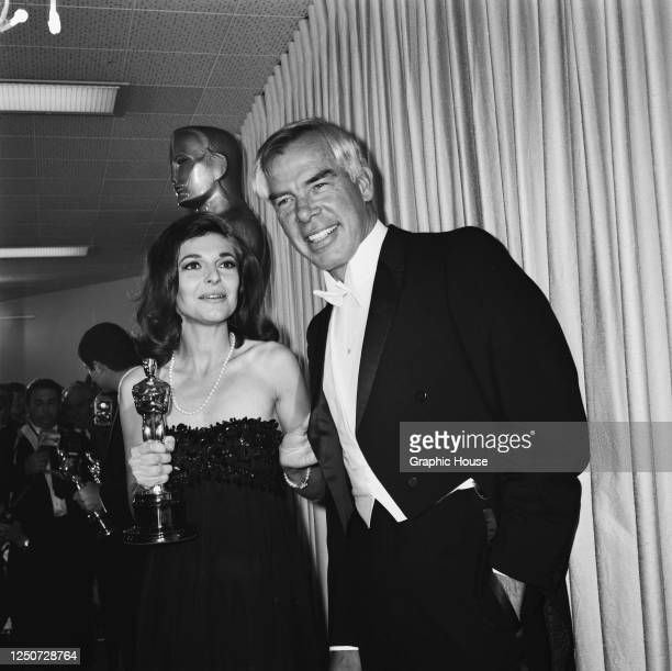Actors Anne Bancroft and Lee Marvin at the 39th Academy Awards in Santa Monica, Los Angeles, 10th April 1967. He is presenting the award for Best...