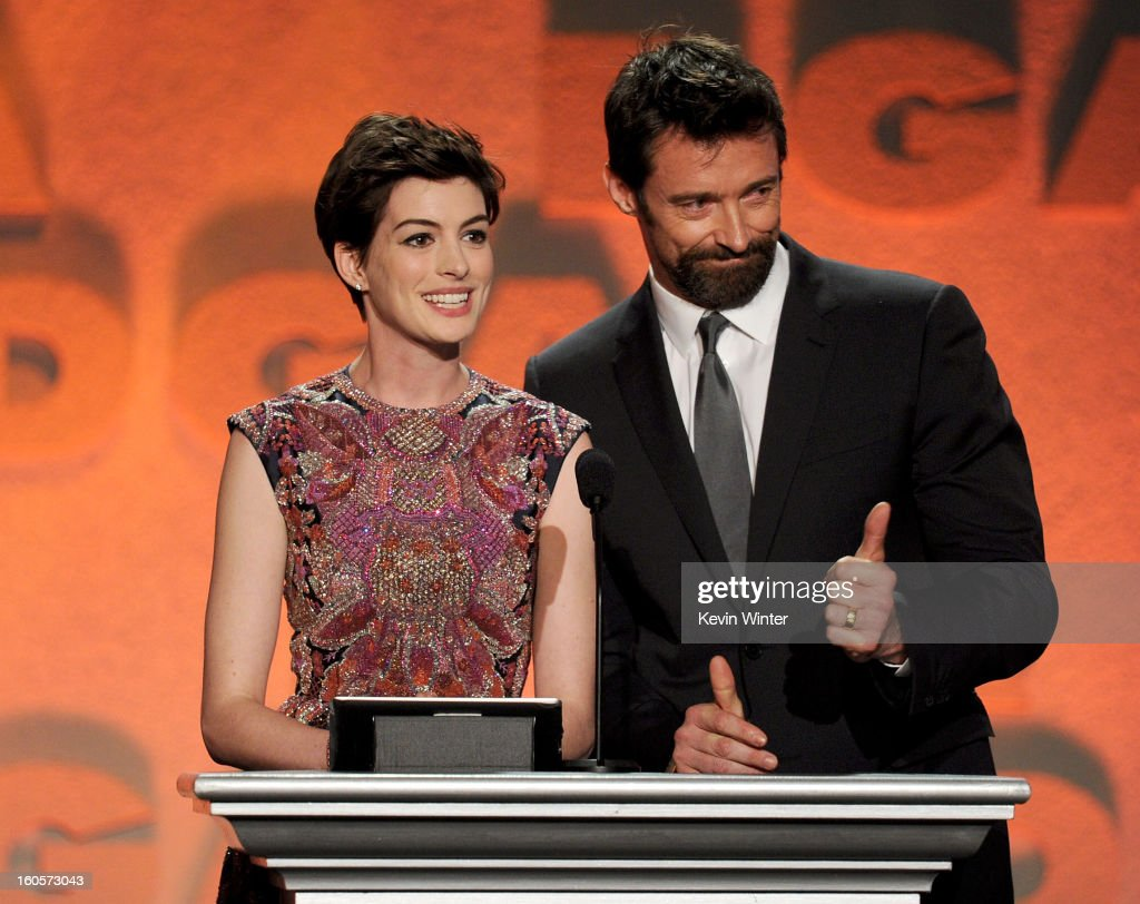 Actors Anne Hathaway and Hugh Jackman speak onstage during the 65th Annual Directors Guild Of America Awards at Ray Dolby Ballroom at Hollywood & Highland on February 2, 2013 in Los Angeles, California.