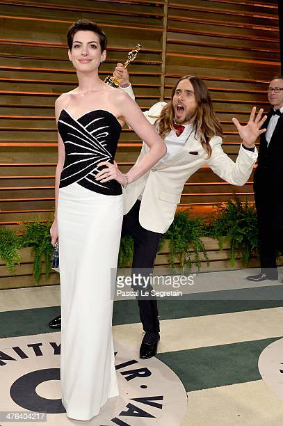 Actors Anne Hathaway and Jared Leto attend the 2014 Vanity Fair Oscar Party hosted by Graydon Carter on March 2 2014 in West Hollywood California