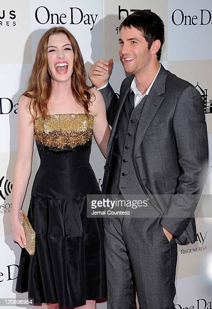 Actors Anne Hathaway and Jim Sturgess pose for a photo on the red carpet at the One Day premiere at the AMC Loews Lincoln Square 13 theater on August...