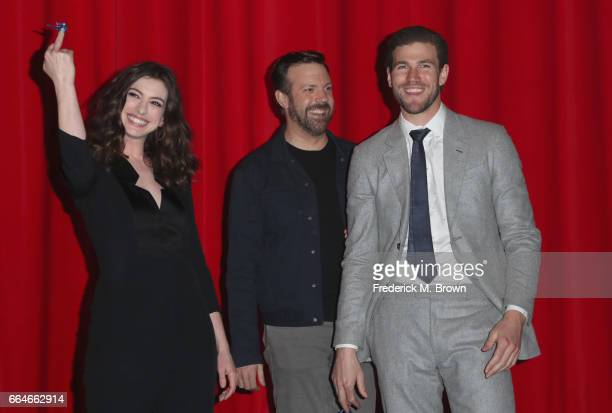 Actors Anne Hathaway Jason Sudeikis and Austin Stowell attend the Premiere Of Neon's Colossal at the Vista Theatre on April 4 2017 in Los Angeles...