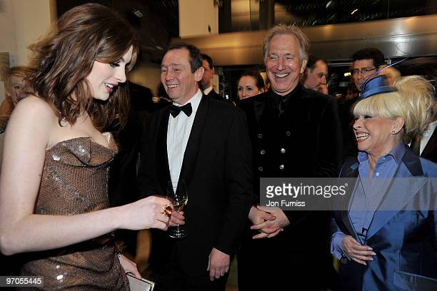 Actors Anne Hathaway Paul Whitehouse Alan Rickman and Barbara Windsor share a joke as they attend the Royal World Premiere of Tim Burton's 'Alice In...