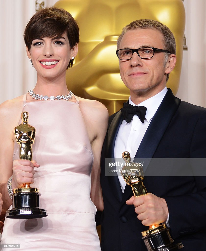 Actors Anne Hathaway, winner of the Best Supporting Actress award for 'Les Miserables,' and Christoph Waltz, winner of the Best Supporting Actor award for 'Django Unchained,' pose in the press room during the Oscars held at Loews Hollywood Hotel on February 24, 2013 in Hollywood, California.