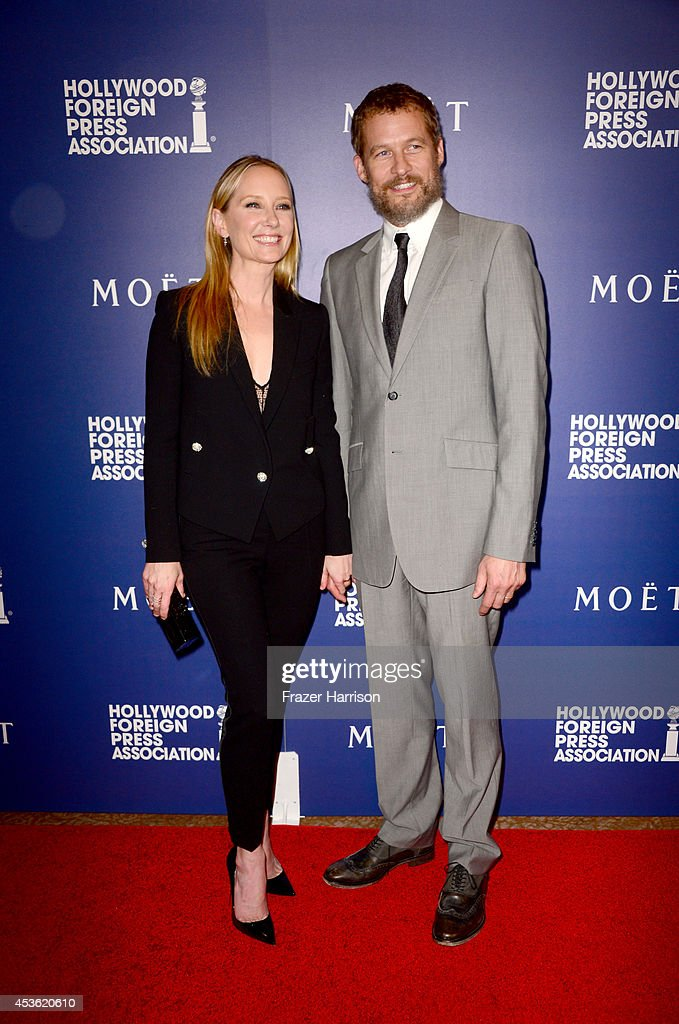 Actors Anne Heche (L) and James Tupper attend the Hollywood Foreign Press Association's Grants Banquet at The Beverly Hilton Hotel on August 14, 2014 in Beverly Hills, California.