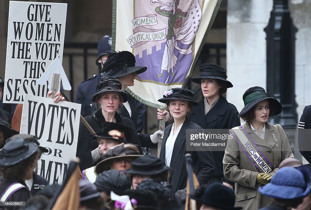Actors (L-R) Anne-Marie Duff, Carey Mulligan and Helena Bonham Carter take part in filming of the movie Suffragette at Parliament on April 11, 2014 in London, England. This is the first time filming for a movie has been allowed in The Houses of Parliament. Suffragette is due for release in 2015.