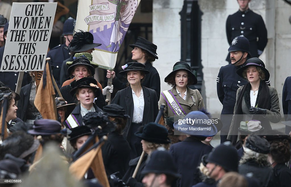 Actors (L-R) Anne-Marie Duff, Carey Mulligan, Helena Bonham Carter and Romola Garai take part in filming of the movie Suffragette at Parliament on April 11, 2014 in London, England. This is the first time filming for a movie has been allowed in The Houses of Parliament. Suffragette is due for release in 2015.