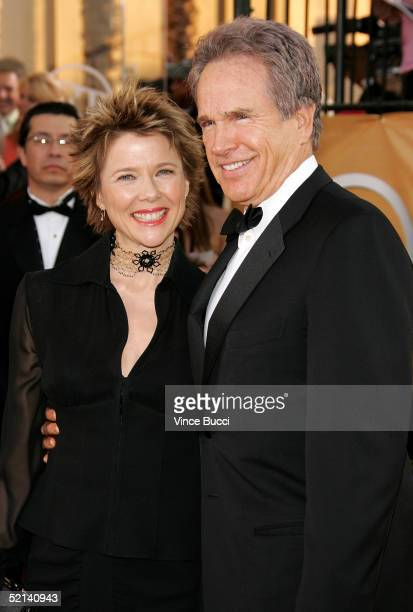 Actors Annette Bening and husband Warren Beatty arrive at the 11th Annual Screen Actors Guild Awards at the Shrine Exposition Center on February 5,...