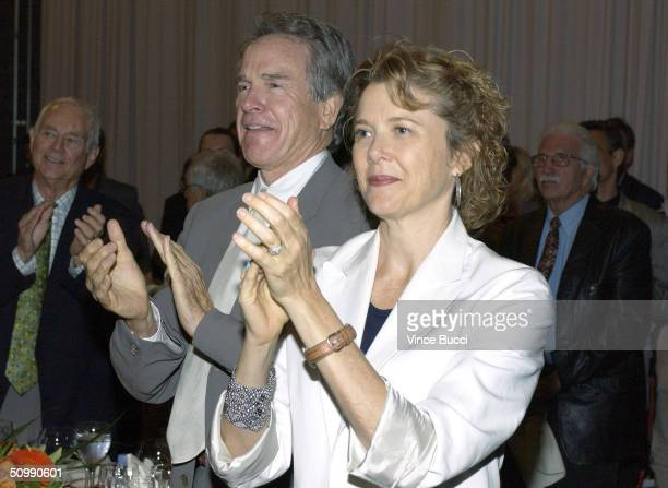 Actors Annette Bening and husband Warren Beatty attend a luncheon honoring entertainment industry executive Robert A Daly with the 2004 Steven J...