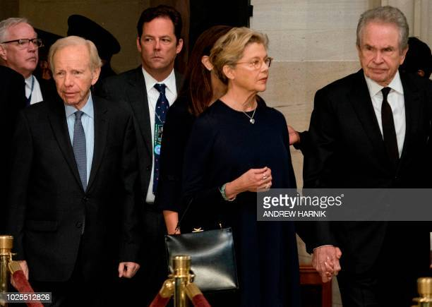 US actors Annette Bening and Warren Beatty arrive with US Senator Joe Lieberman for a ceremony honoring US Senator John McCain at the US Capitol...