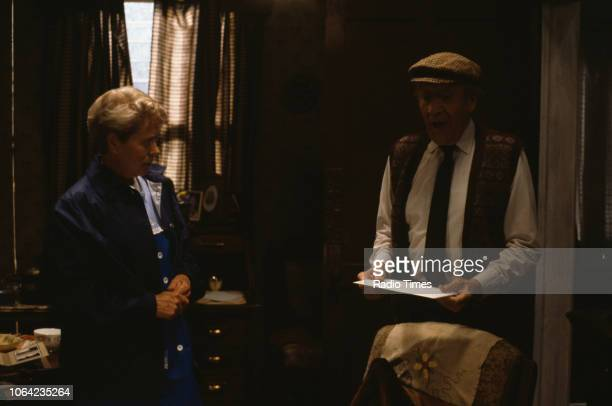 Actors Annette Crosbie and Jimmy Jewel in a scene from episode 'Who Will Buy' of the BBC Television sitcom 'One Foot in the Grave' 1990