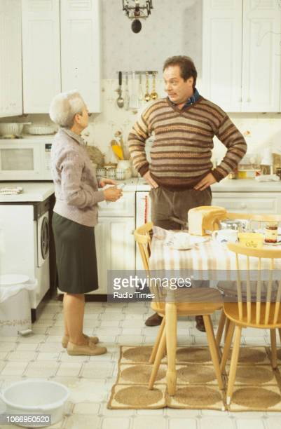 Actors Annette Crosbie and Owen Brenman in a kitchen scene from the Christmas special episode 'Starbound' of the BBC Television sitcom 'One Foot in...
