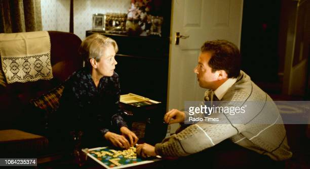 Actors Annette Crosbie and Owen Brenman playing scrabble in a scene from episode 'The Man Who Blew Away' of the BBC Television sitcom 'One Foot in...