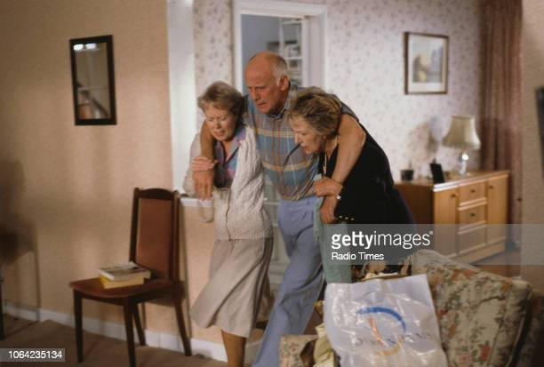 Actors Annette Crosbie Richard Wilson and Doreen Mantle in a scene from episode 'We Have Put Her in the Tomb' of the BBC Television sitcom 'One Foot...