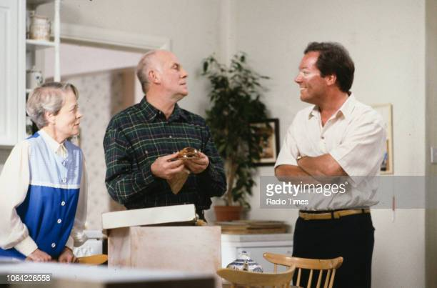 Actors Annette Crosbie Richard Wilson and Owen Brenman in a scene from episode 'Beware the Trickster on the Roof' of the television sitcom 'One Foot...