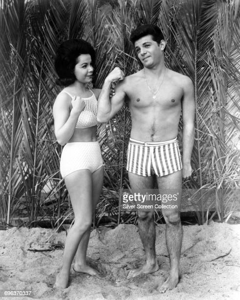 Actors Annette Funicello as Dee Dee and Frankie Avalon as Frankie in the film 'Muscle Beach Party' 1964