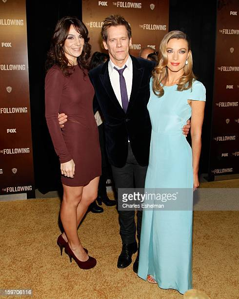 Actors Annie Parisse Kevin Bacon and Natalie Zea attend 'The Following' premiere at The New York Public Library on January 18 2013 in New York City