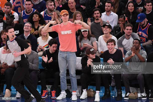Actors Ansel Engort and Timothee Chalamet attend the game between the Philadelphia 76ers and the New York Knicks at Madison Square Garden on March 15...
