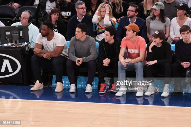 Actors Ansel Engort Timothee Chalamet and New York Giants legend Justin Tuck attend the game between the Philadelphia 76ers and the New York Knicks...