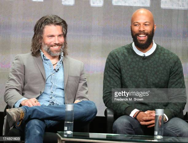 Actors Anson Mount and Common speak onstage during the Hell On Wheels panel discussion at the AMC portion of the 2013 Summer Television Critics...