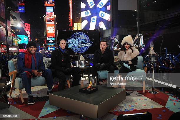 Actors Anthony Anderson Jane Lynch Carson Daly and Natasha Leggero attend New Year's Eve 2013 With Carson Daly in Times Square on December 31 2013 in...
