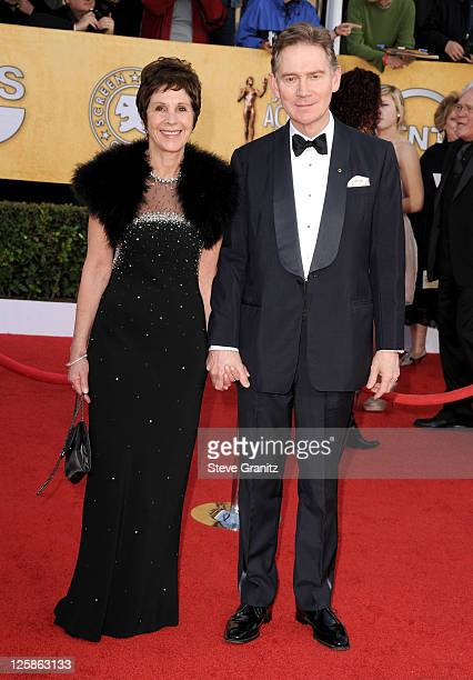Actors Anthony Andrews and Georgina Simpson arrive at the 17th Annual Screen Actors Guild Awards held at The Shrine Auditorium on January 30 2011 in...