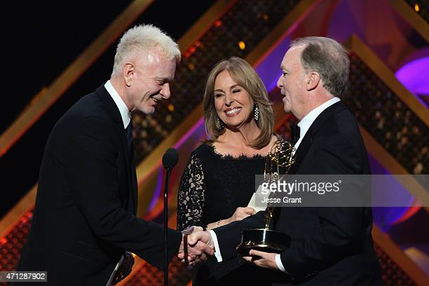 Actors Anthony Geary and Genie Francis present executive producer Ken Corday with the 'Outstanding Drama Series' for 'Days of Our Lives' onstage...