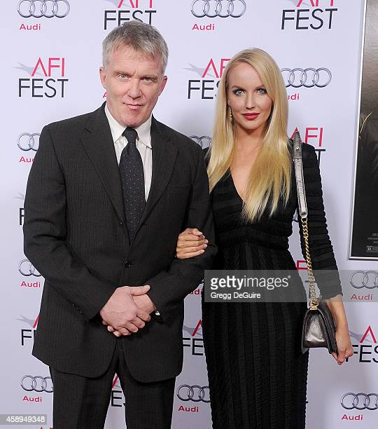 Actors Anthony Michael Hall and Lucia Oskerova arrive at the AFI FEST 2014 Presented By Audi Closing Night Gala Premiere of 'Foxcatcher' at Dolby...